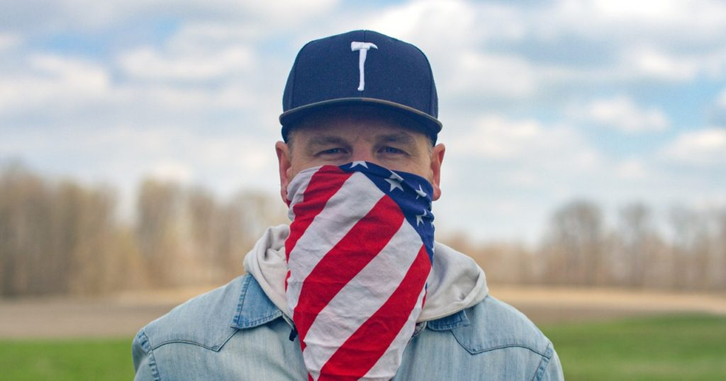 Man with American flag bandana wrapped around his head