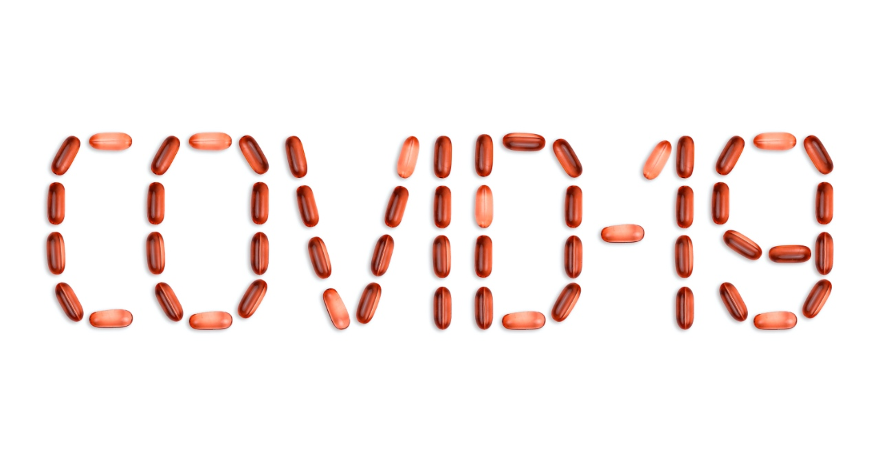 Supplement pills arranged to spell COVID-19